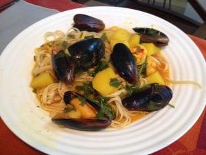 saffron seafood stew over linguine